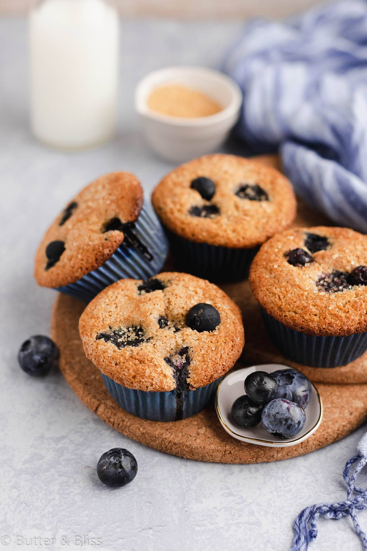 Small batch of gluten free blueberry muffins on a trivet
