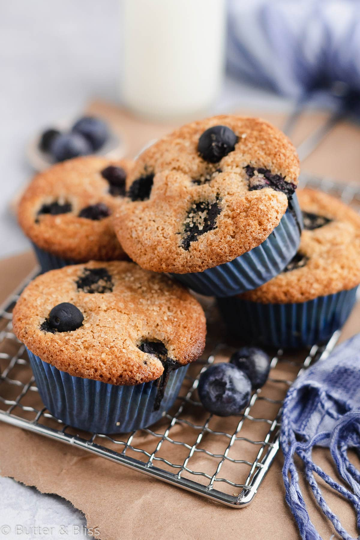 Blueberry muffins stacked on a wire rack