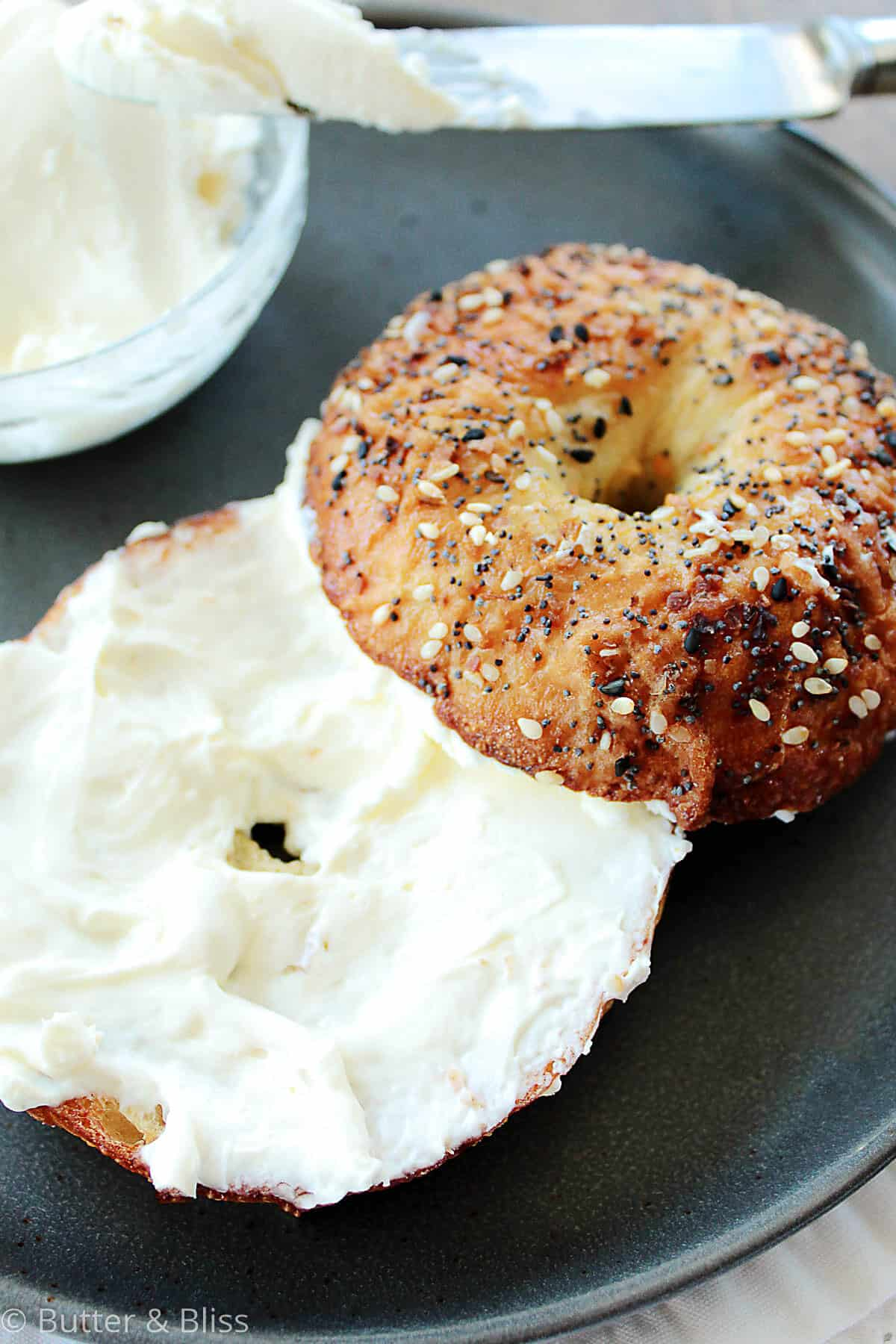 Bagel with cream cheese on a plate