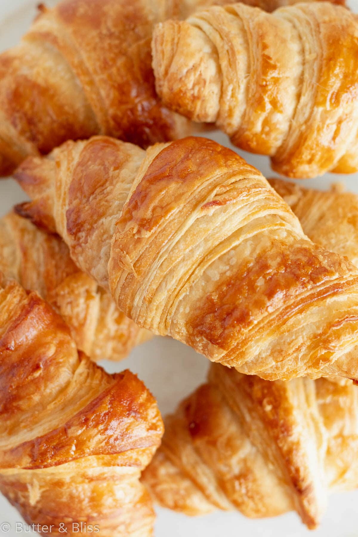 Close up of flaky layers of a homemade croissant