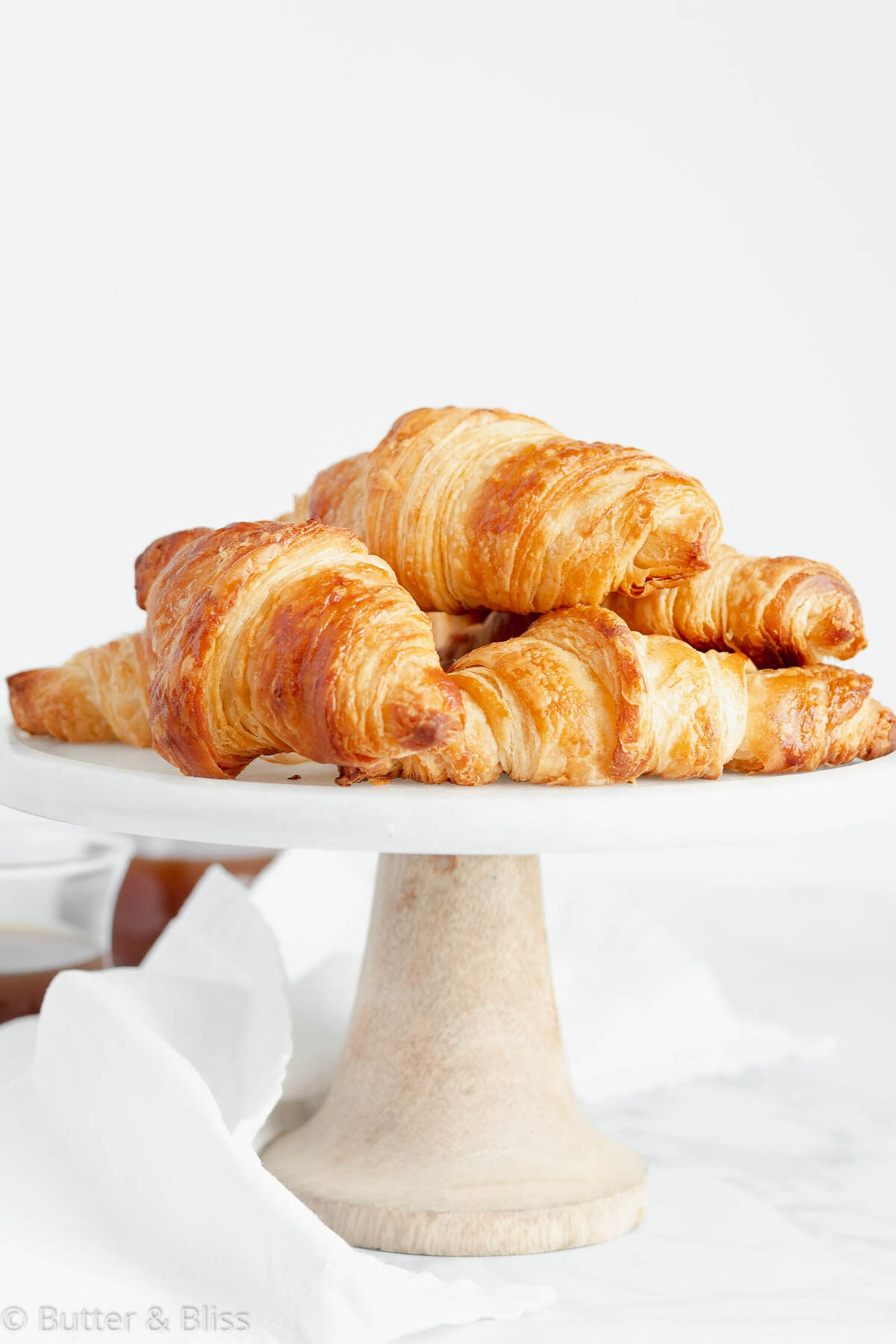 Fresh baked croissants on a serving plate