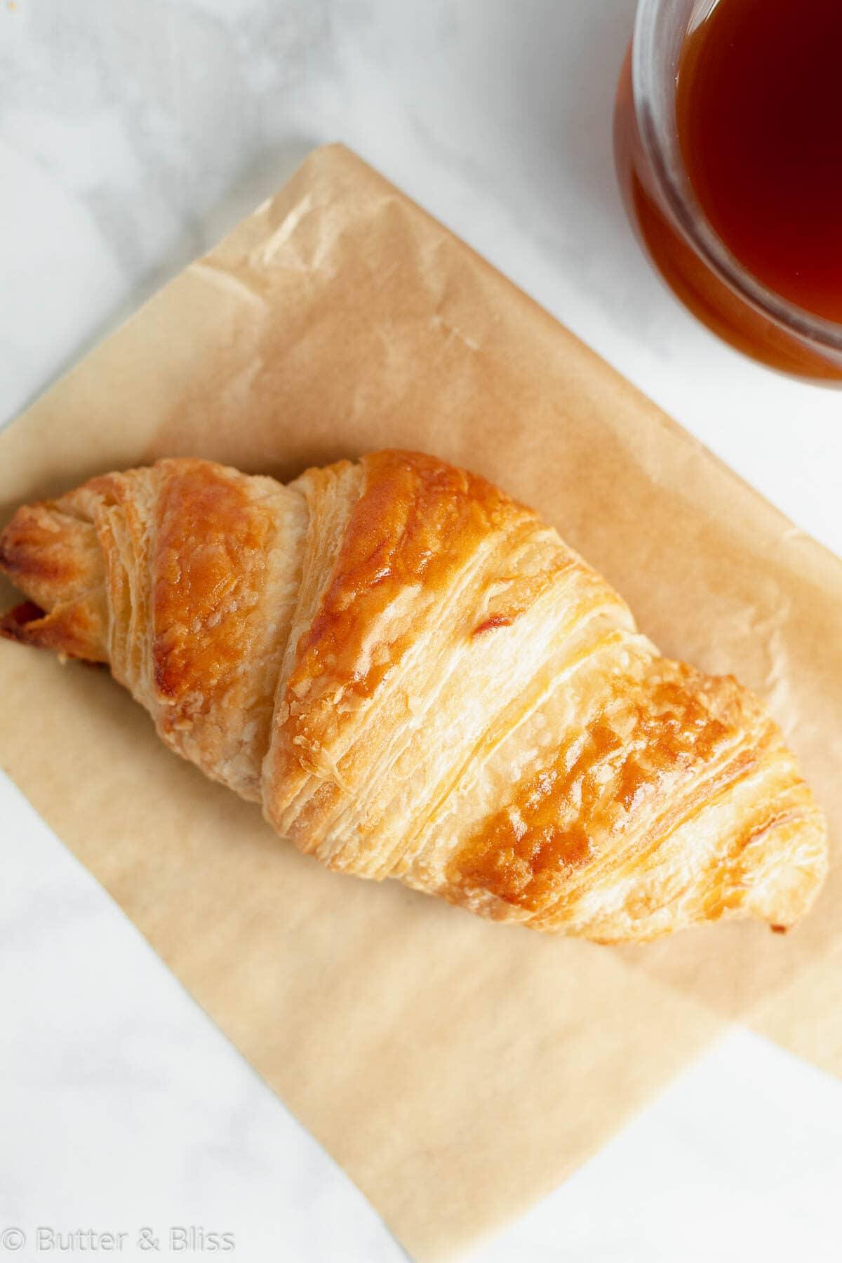 Single croissant on a napkin