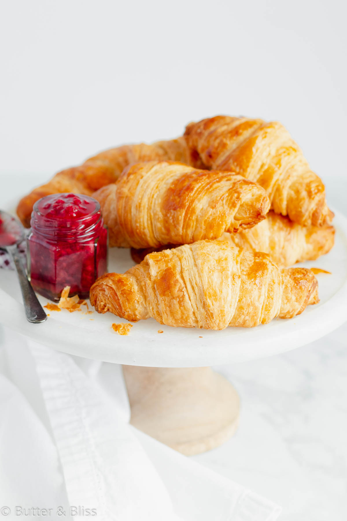 Croissants on a platter with jam