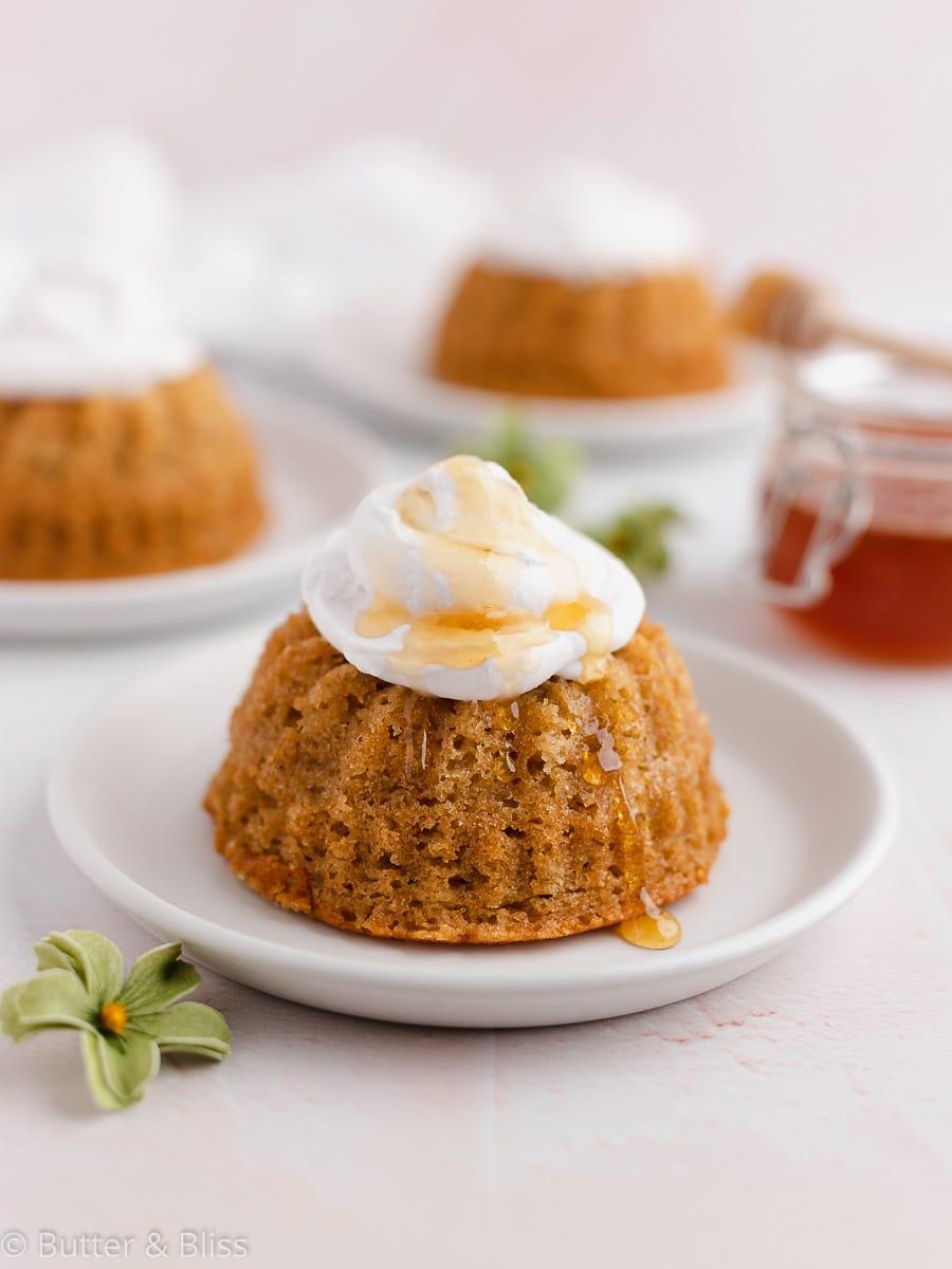 Mini honey orange bundt cakes on plates