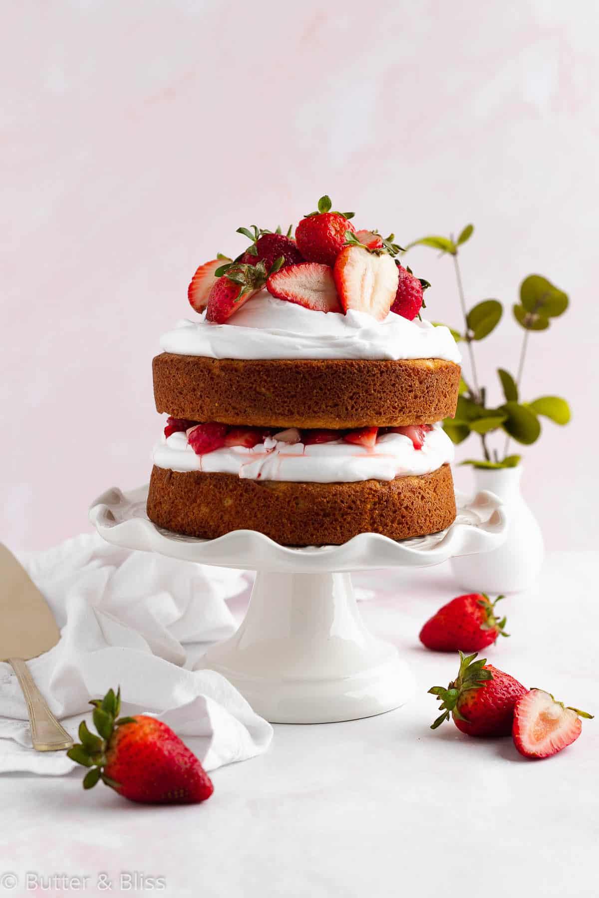 Strawberry shortcake layer cake on a cake platter