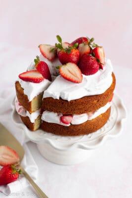 Mini strawberry cake with a slice cut