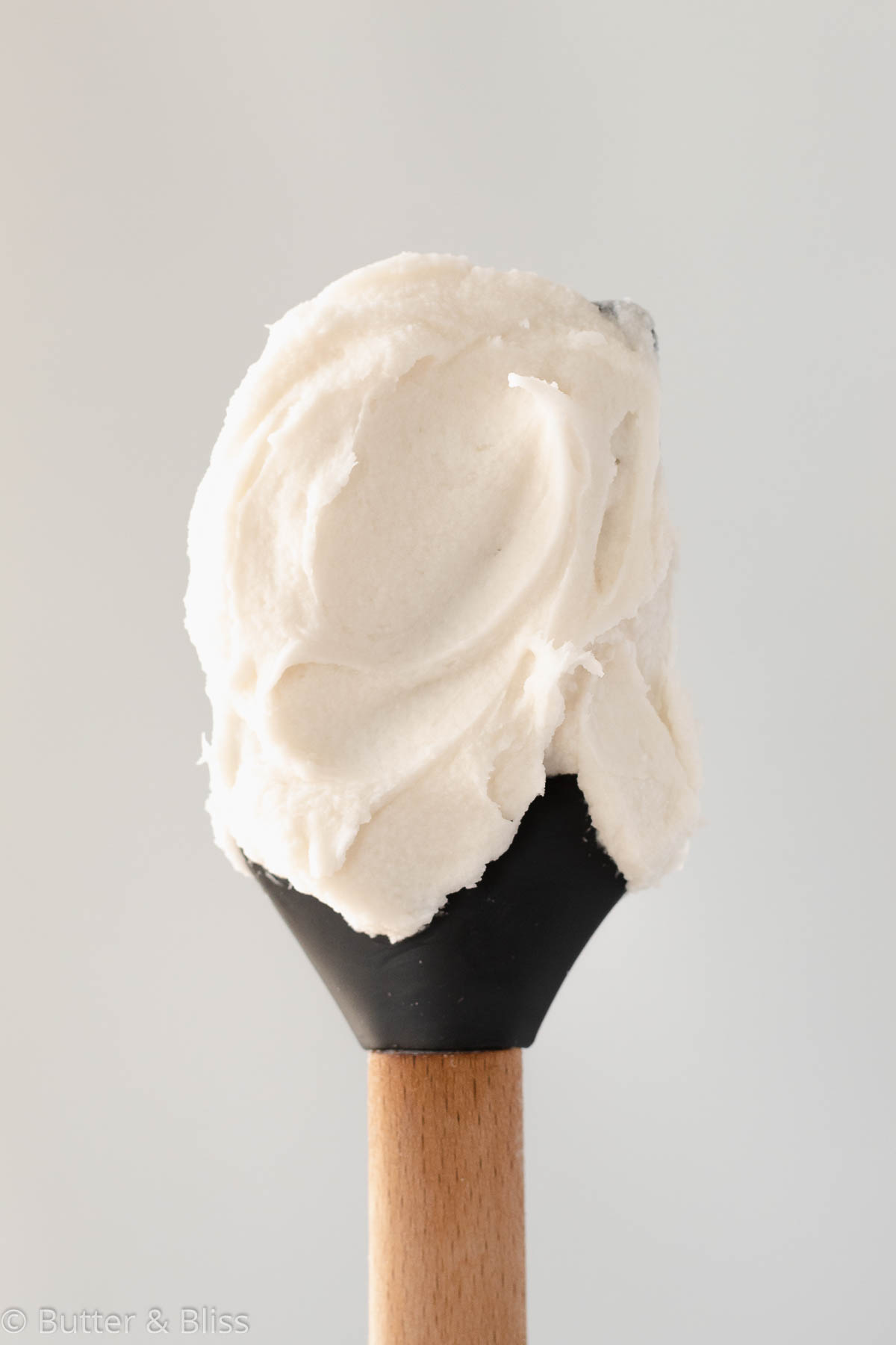 Vanilla frosting on a spatula
