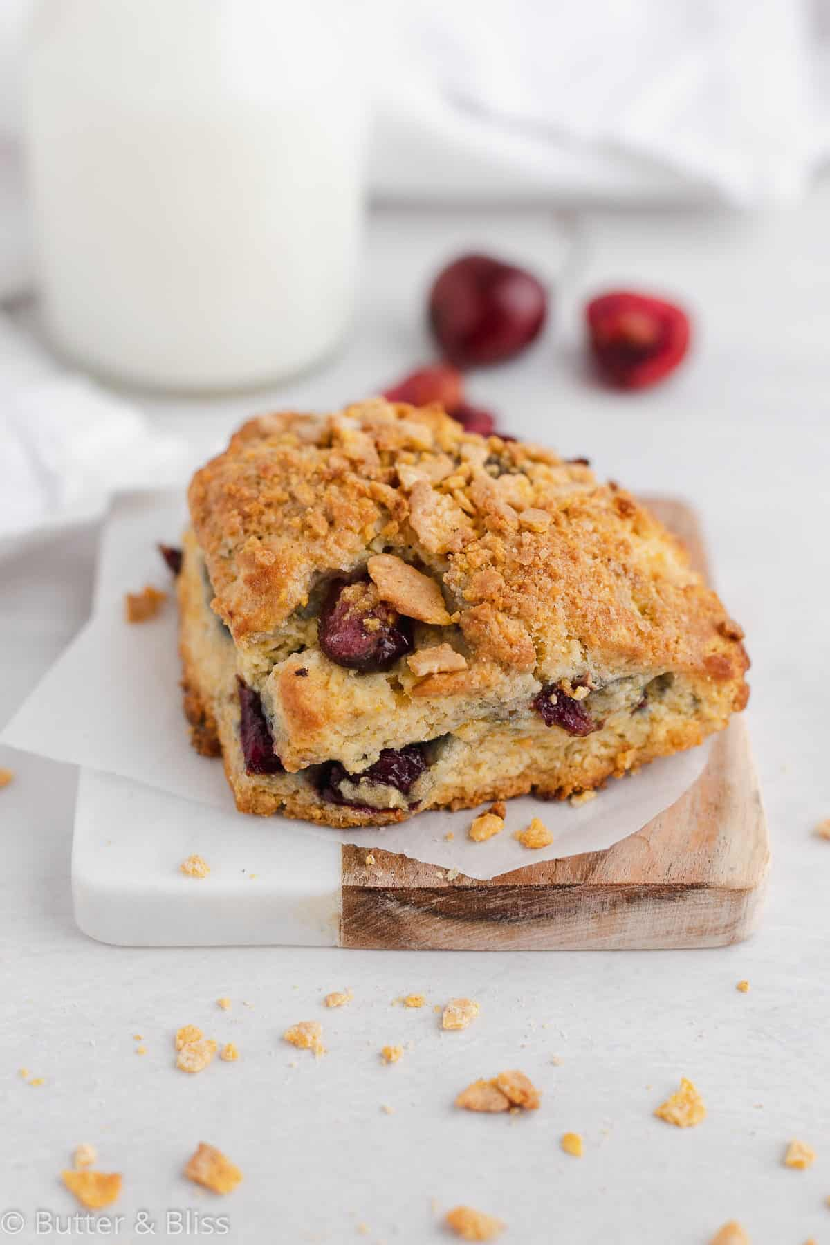 Cherry cornmeal scone with cornflake topping on a plate