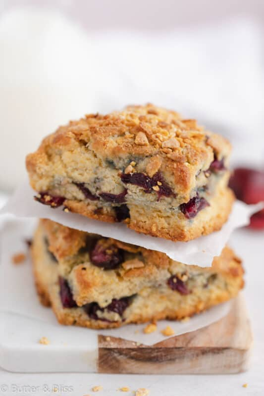 Stacked cherry cornmeal scones topped with cornflake crunch