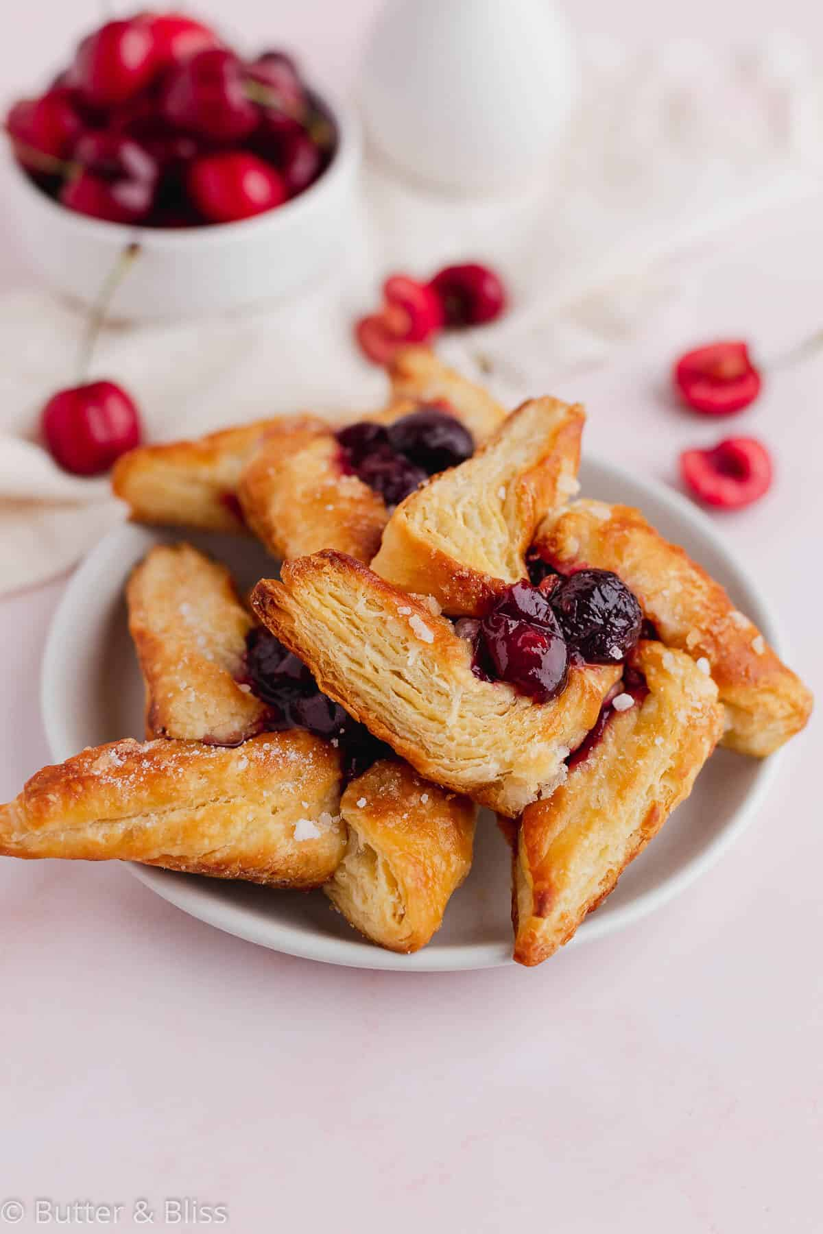 A plate of cherry filled danish patries