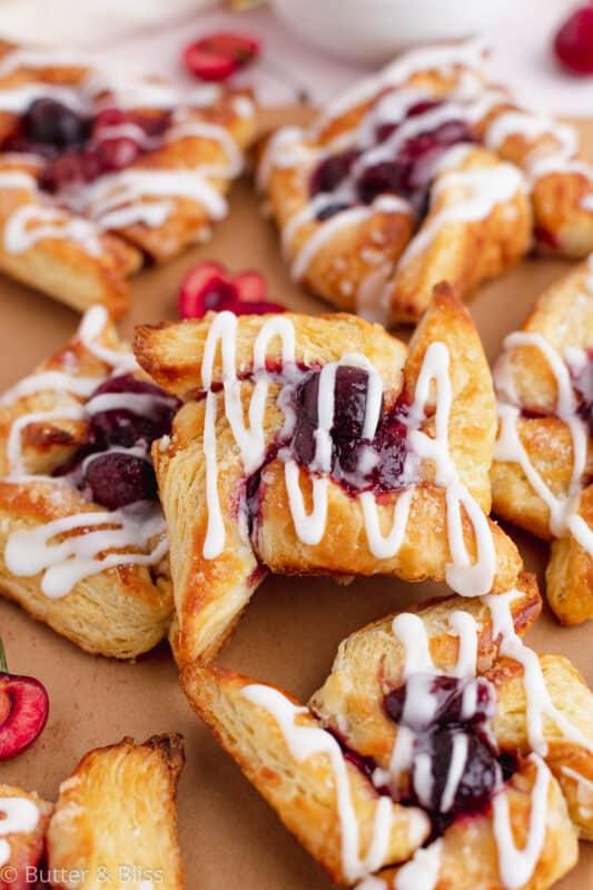 A plate of cherry pinwheel danish pastry