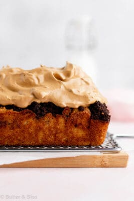 Side view of a mocha coffee cake with dalgona whip