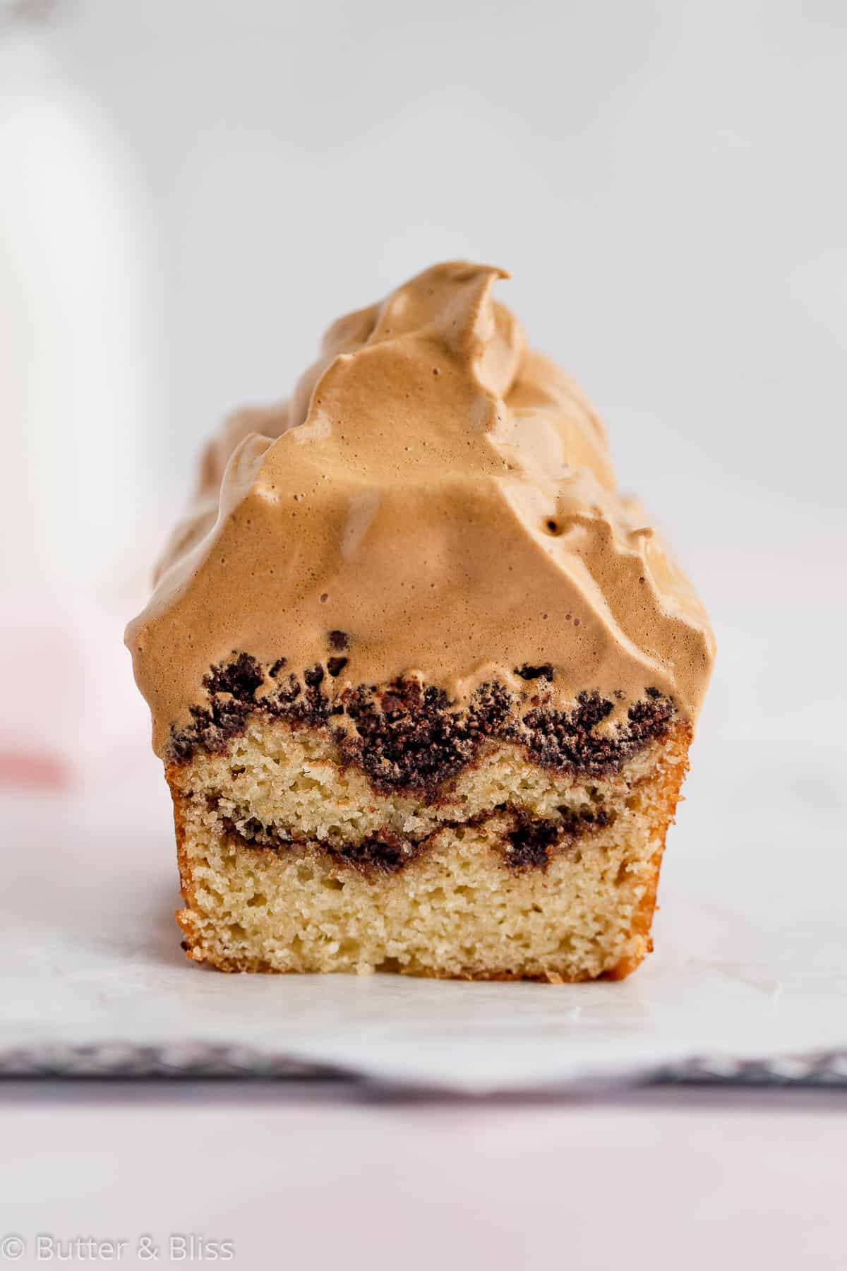 Slice of mocha coffee cake with coffee whipped topping