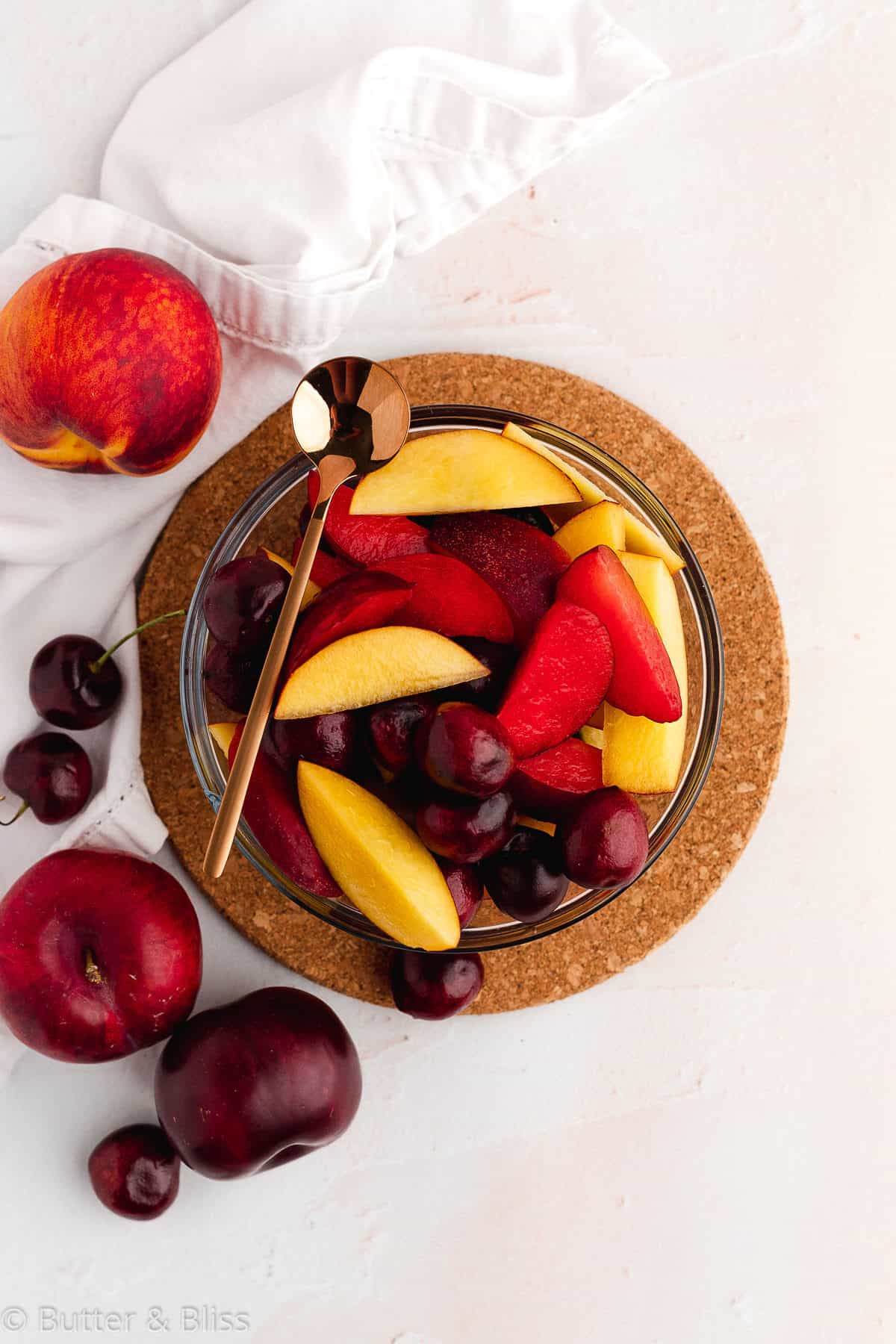 Bowl of fresh stone fruit for chocolate cobbler