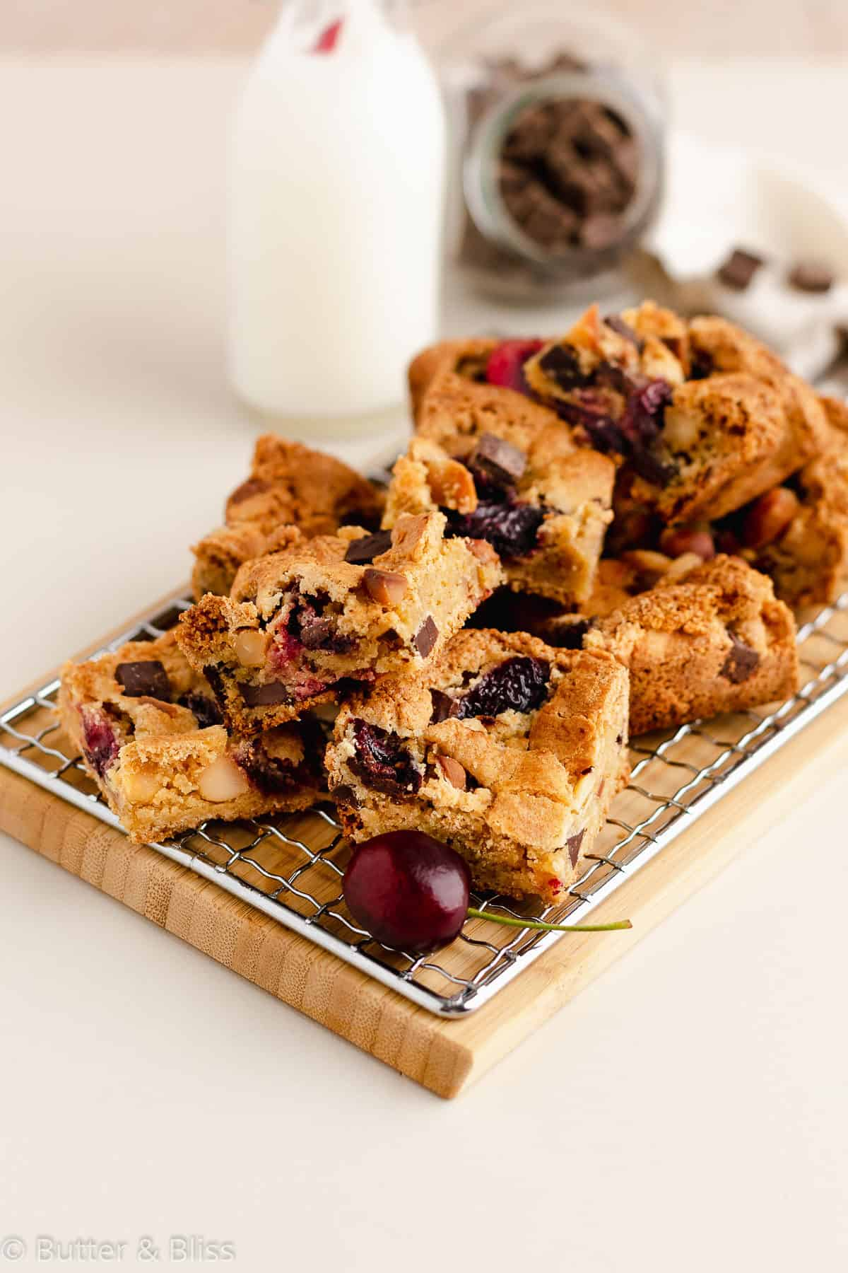 Gluten free blondie squares with chocolate, cherries, and macadamia nuts