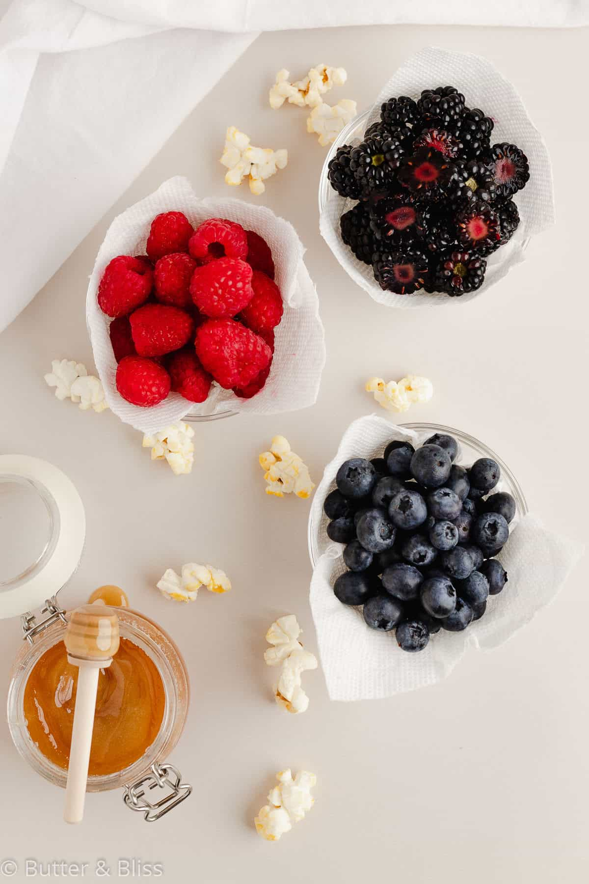 Fresh summer berries in small bowls