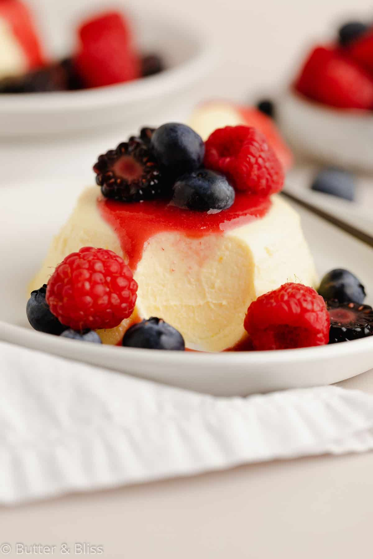 A bite of panna cotta with summer berries