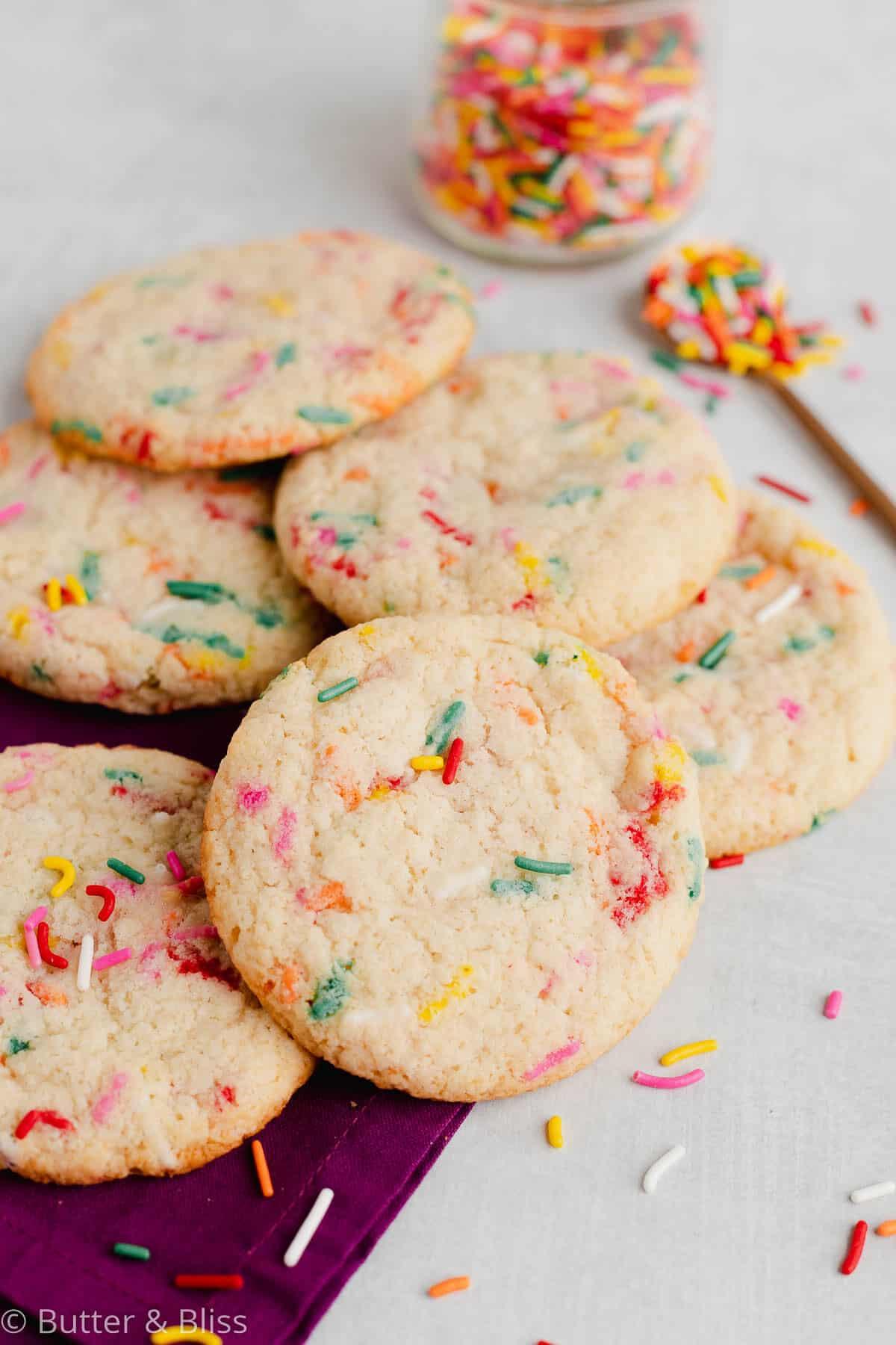 Gluten free funfetti sugar cookies on a napkin