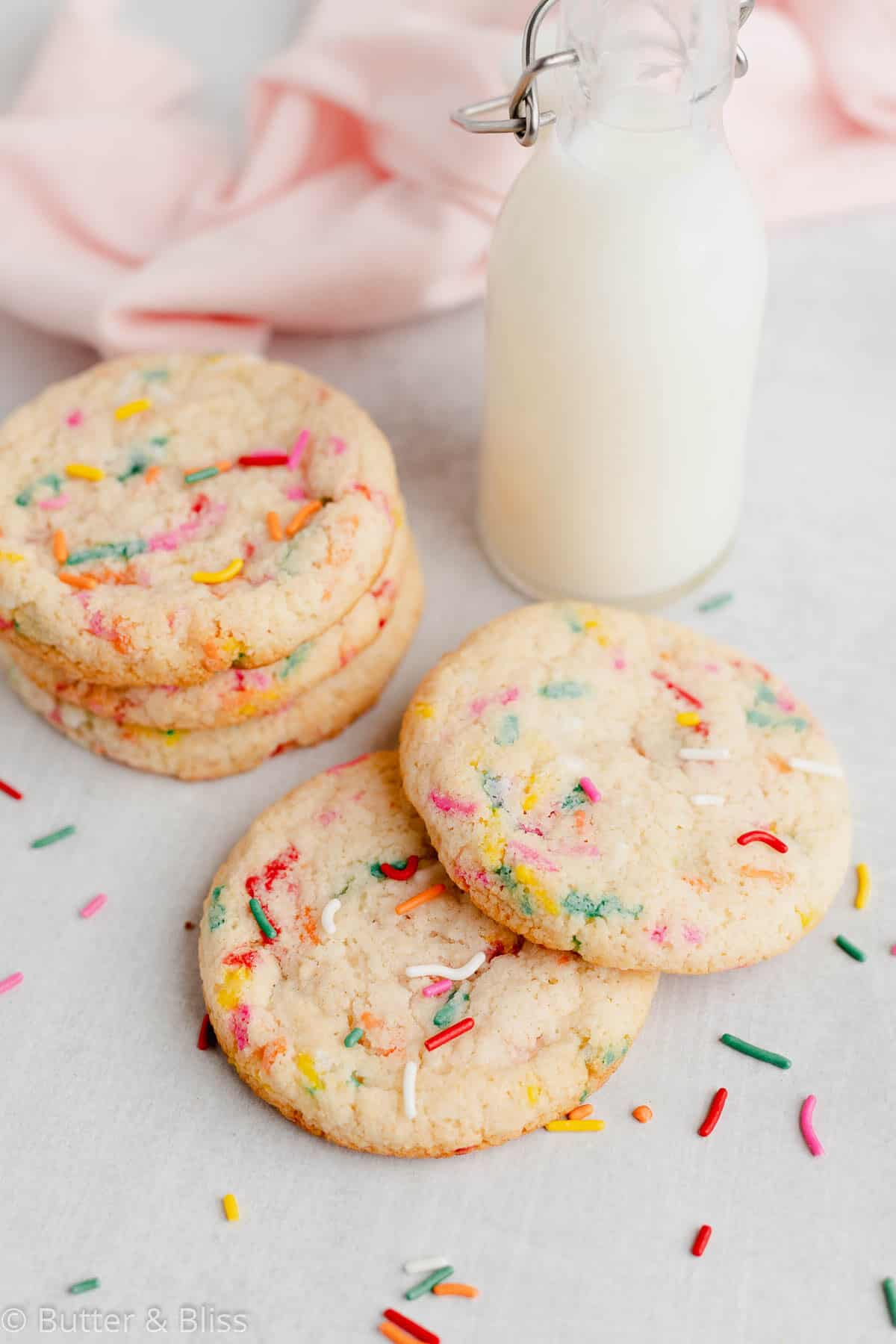 Gluten free sugar cookies with sprinkles with a glass of milk