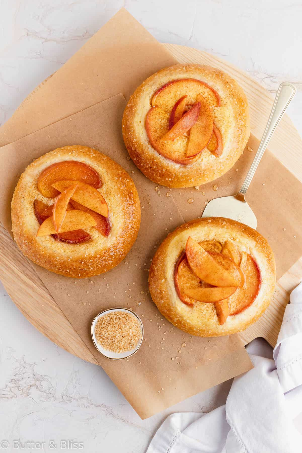 Small batch of fresh peach kuchen on a cutting board