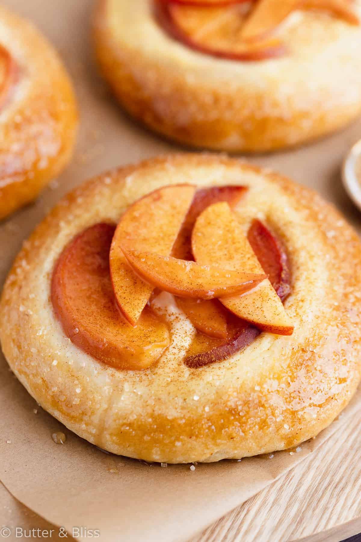 Close up of a peach and vanilla custard mini kuchen pie