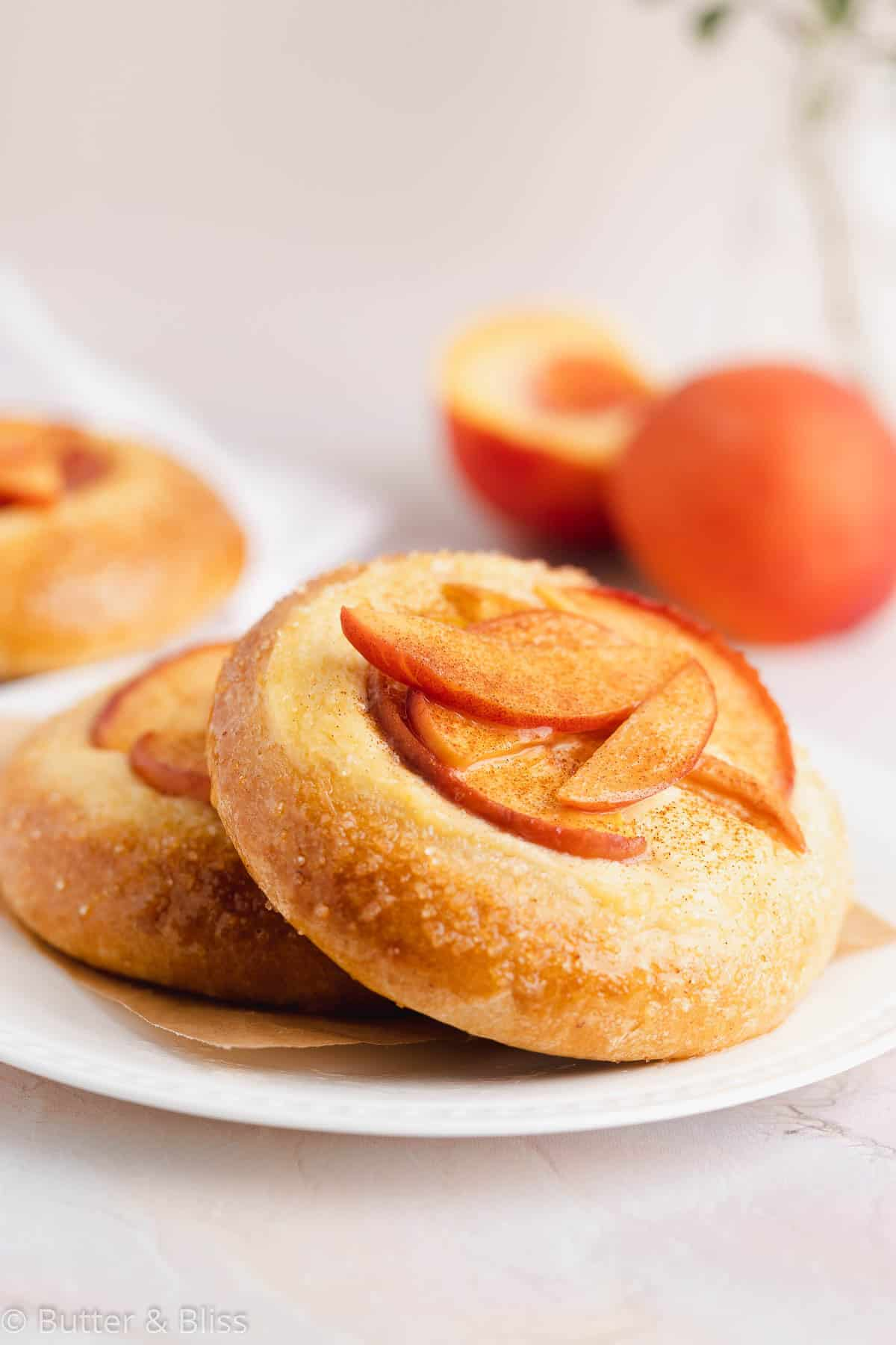 A peach and custard mini pie on a plate