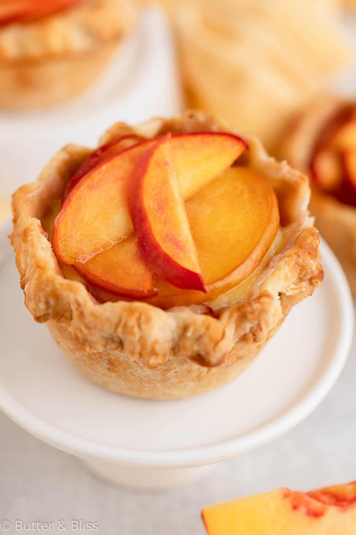 Mini peach pie on a small cupcake stand