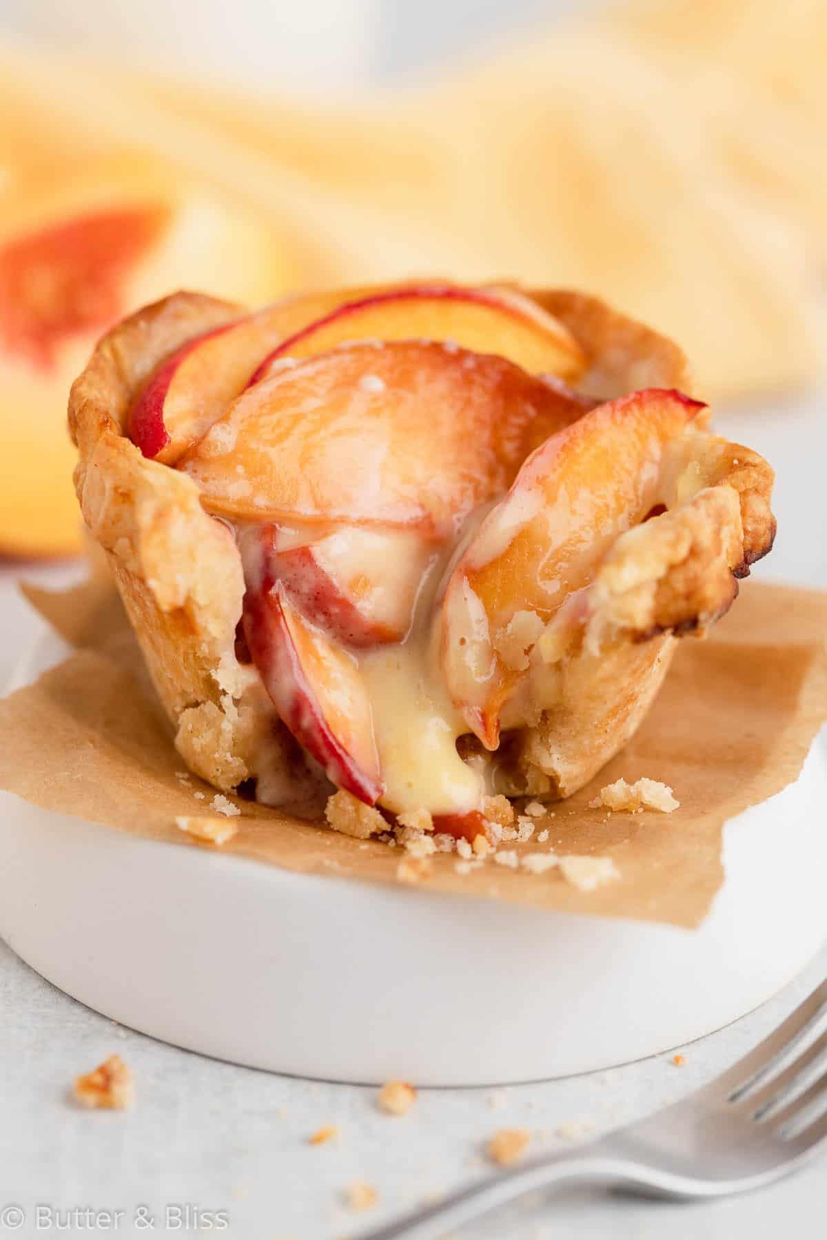 Mini peach and cream pie with a bite
