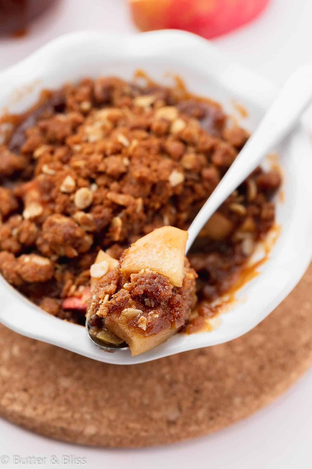 Apple crisp with biscoff on spoon