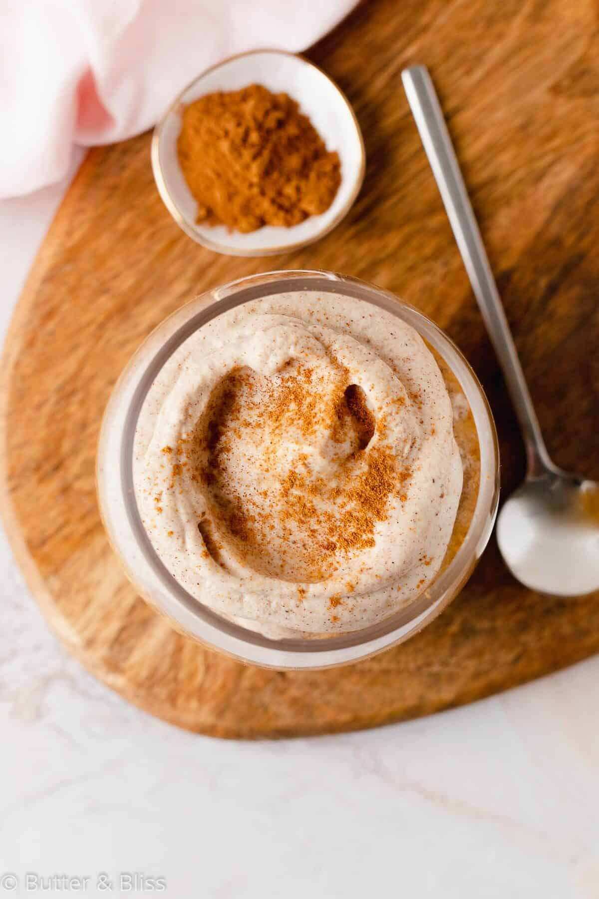 Pumpkin spice latte oats with whipped cream topping