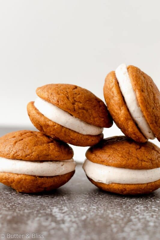 Small batch of pumpkin whoopie pies stacked in a pyramid