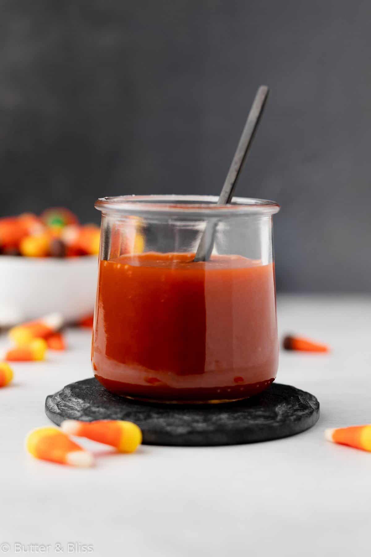 Candy corn caramel sauce in a small jar
