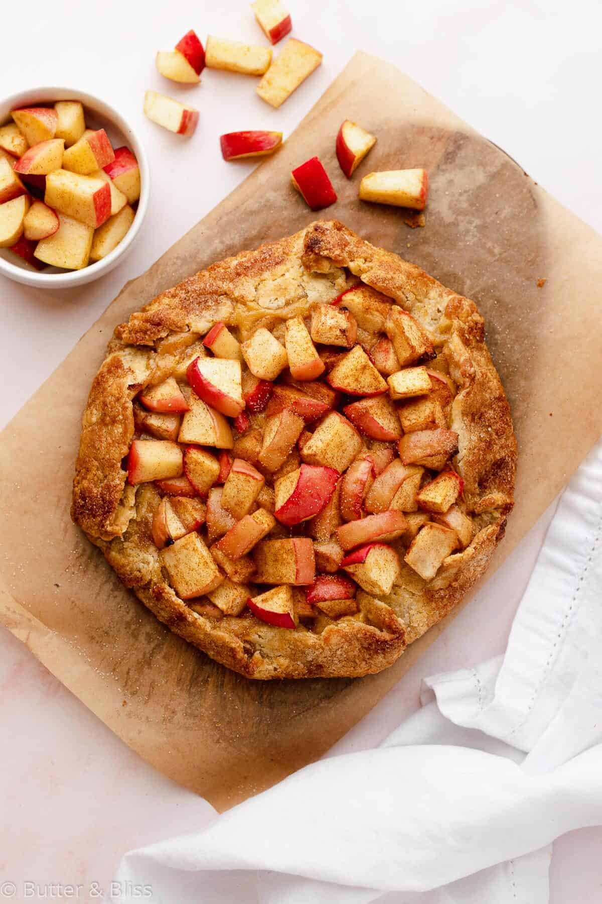 Apple galette cooling on a wood board