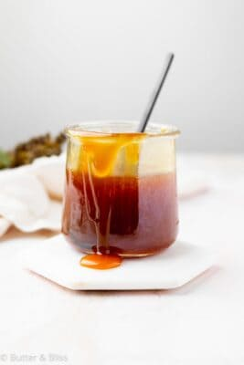 Maple syrup caramel sauce in a small jar